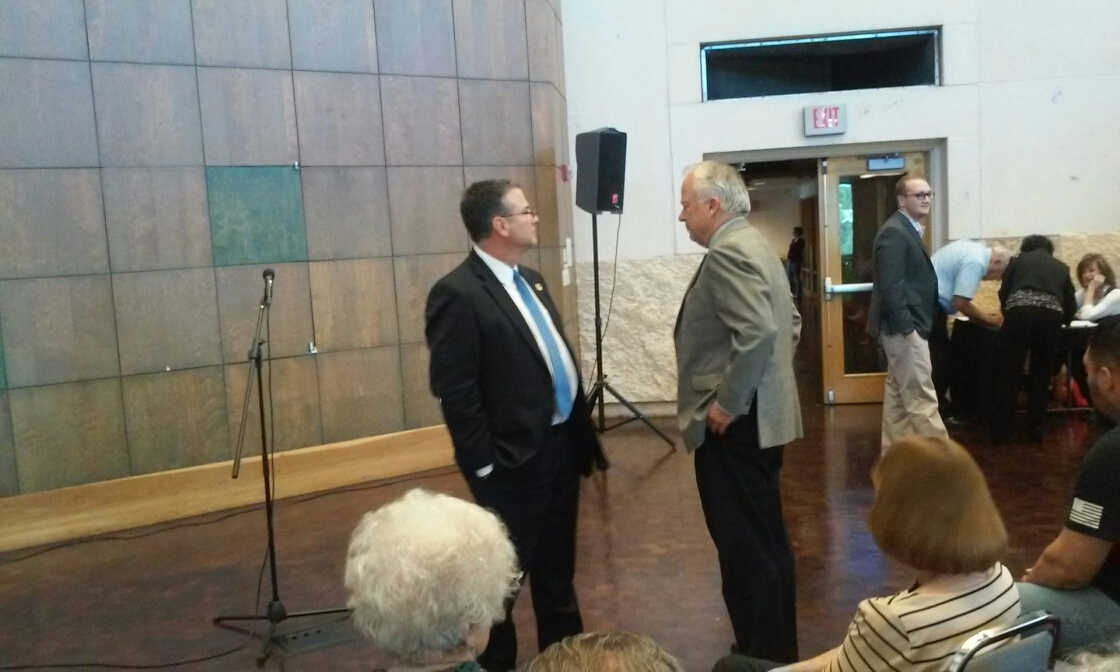State Senator Charles Perry visits with Jim Hughes at the San Angelo Museum of Fine Arts