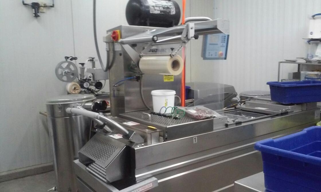 Automated package vacuum sealer at Sklenarik's Smoked Meats.  Yantis Green Photo.