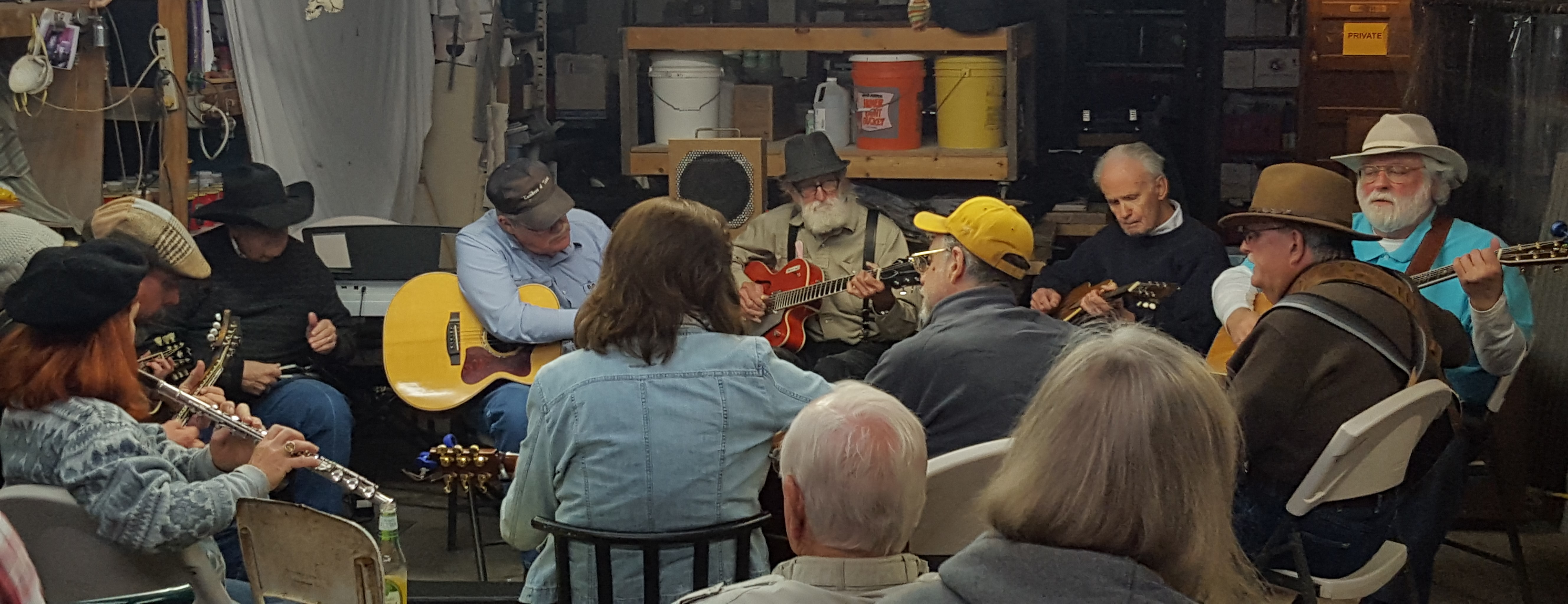 The Chicken Pickers gather in a circle of local musicians