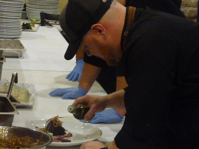 Executive Chef Tim Condon drizzles Truffle Oil on Beef Tenderloin (Photo Holiday Bailey)