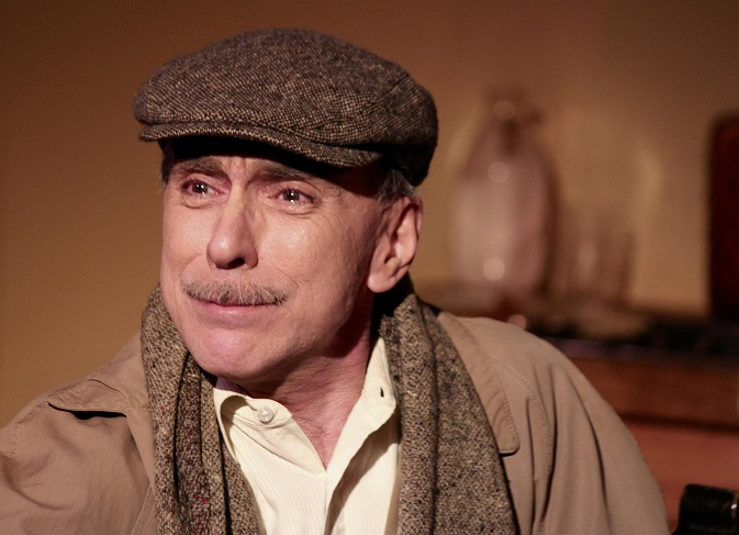 Otto Frank in last photo up close with tears in eyes is played by Charles Blake.(Photo courtesy of Be Theatre)