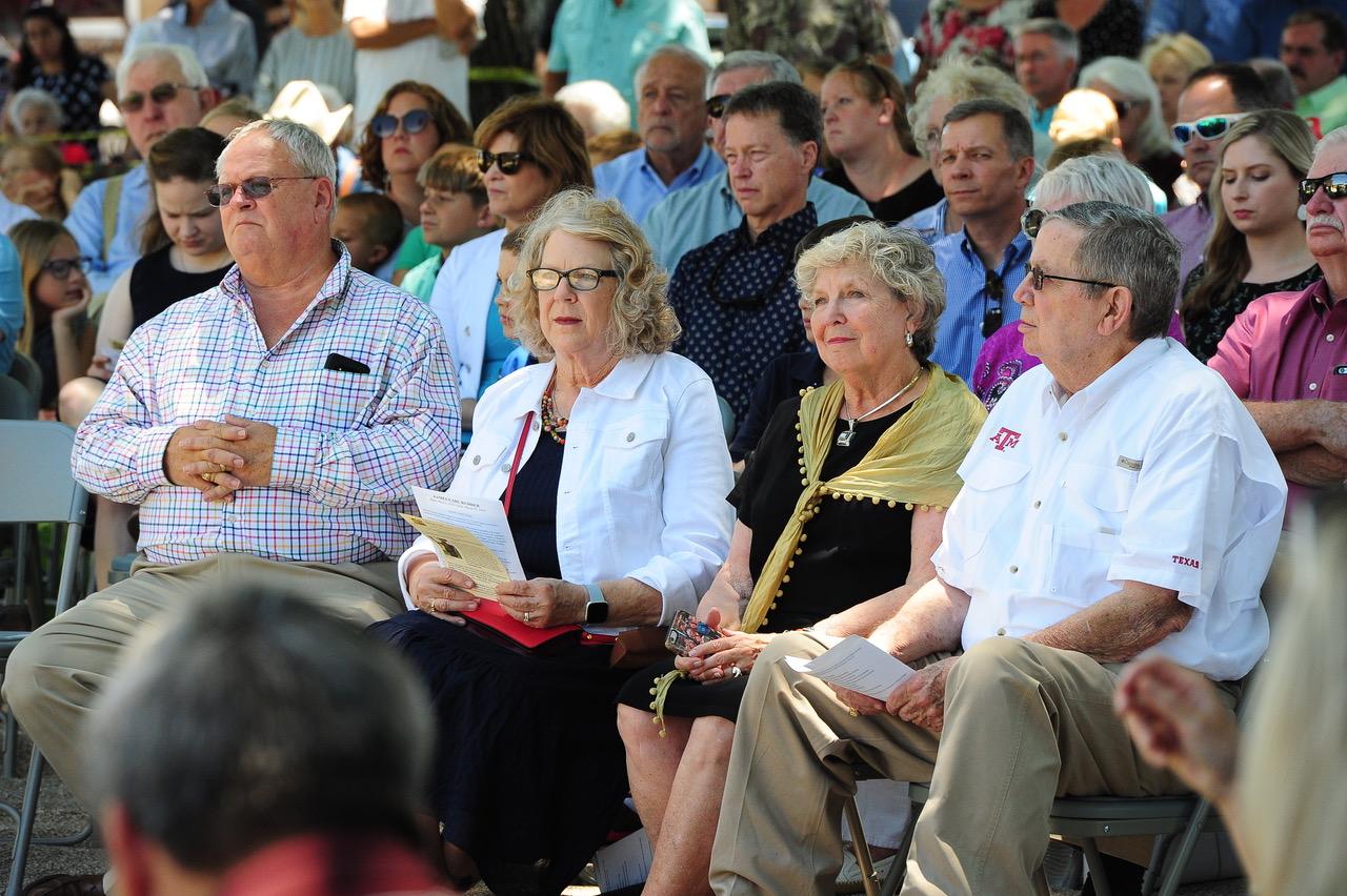 "At the dedication to Earl Rudder at the Brady Square last week. Rudder's children, Anne Rudder Erdman (gold scarf), James ""Bud"" Rudder and Linda Rudder Williams (white jacket).  (Brady Standard-Herald)"
