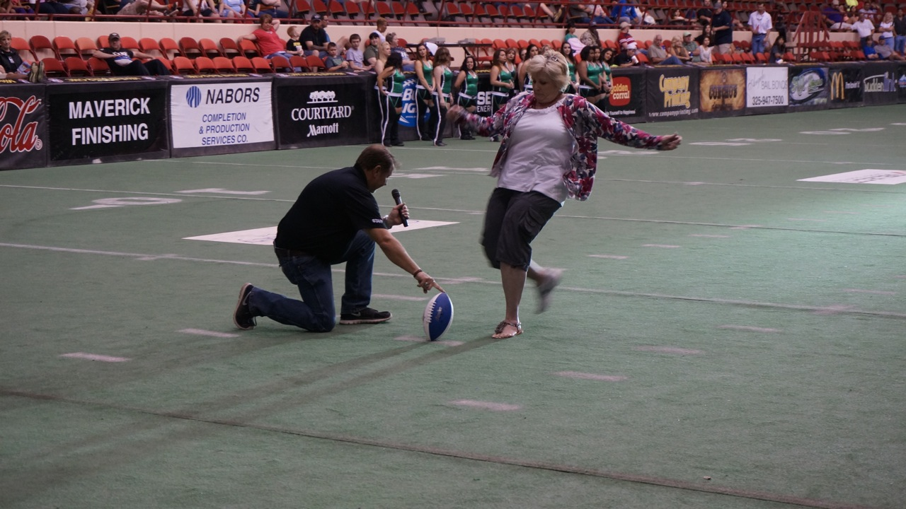 A member of the audience attempts to kick a field goal for a prize. (LIVE! Photo/Joe Hyde)