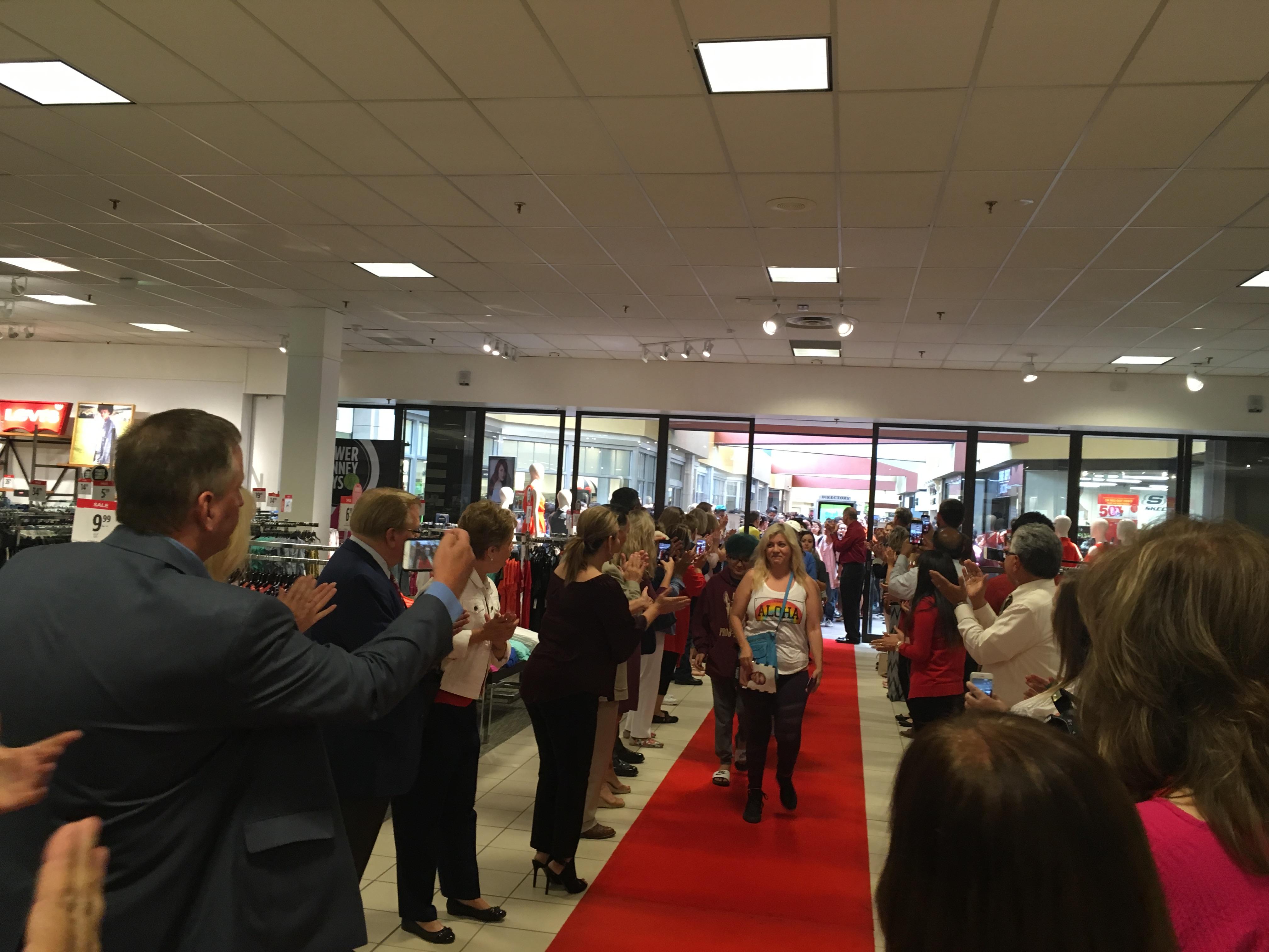 The first customer walks down the Sephora red carpet (LIVE!/Photo: Maura Ballard)