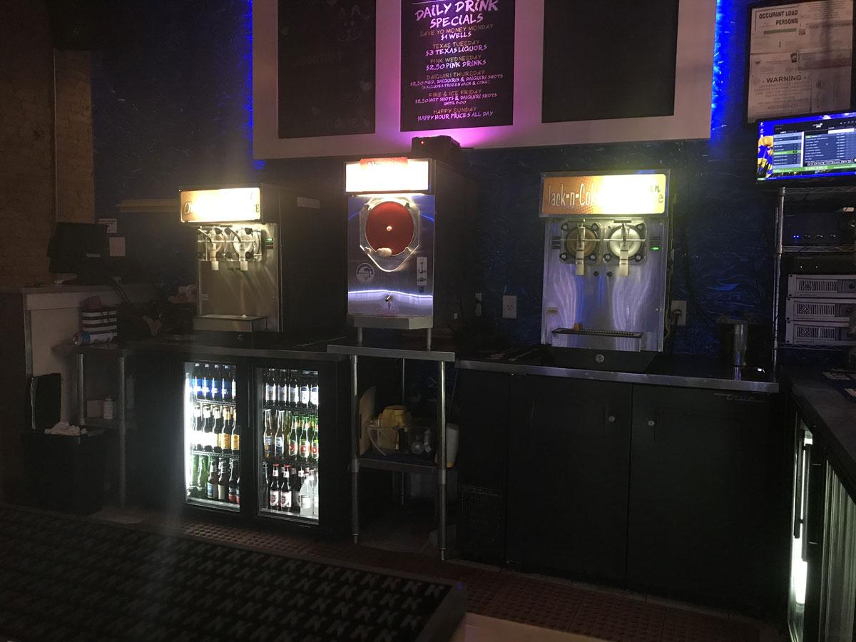The daiquiri machines behind the bar at Grinner's. (LIVE! Photo/Joe Hyde)