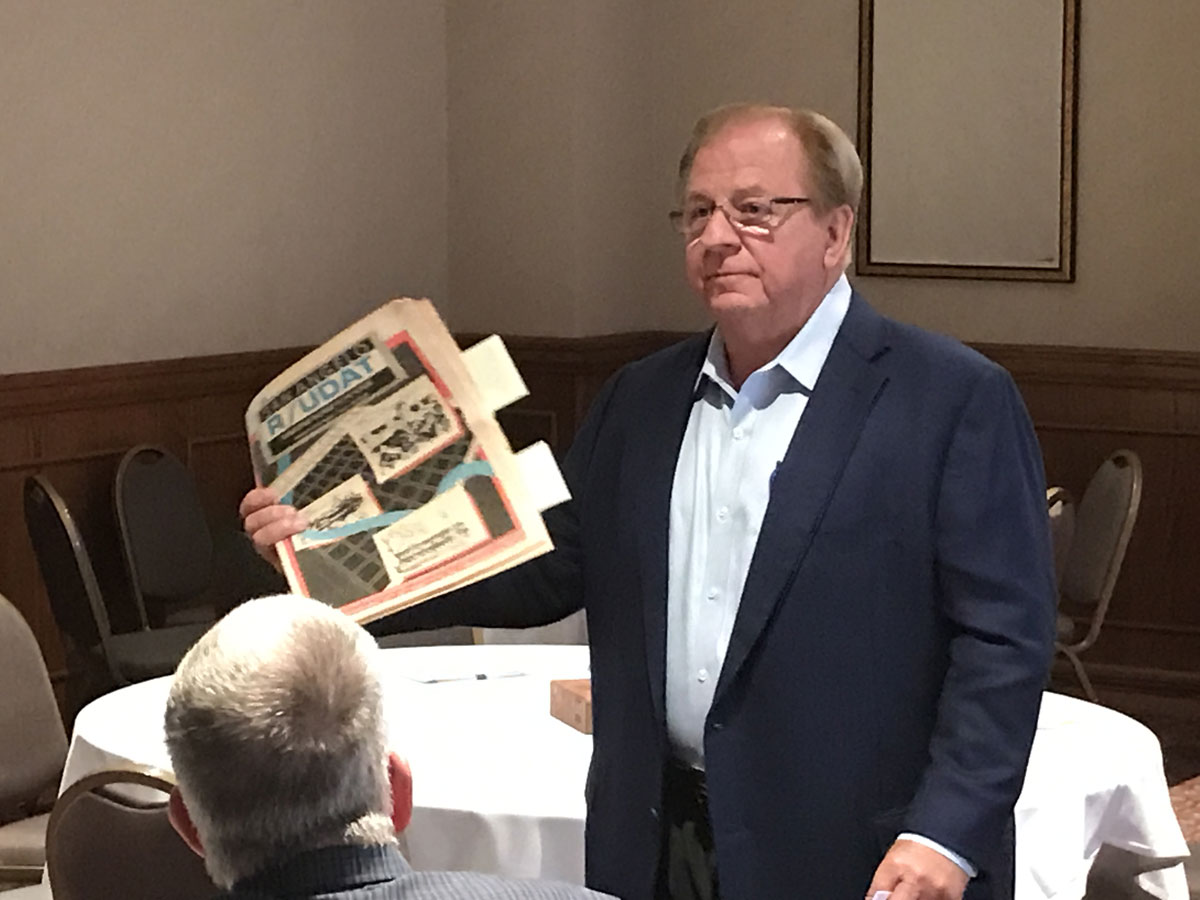 Lee Pfluger holds up the 1992 study called R/UDAT and said it contains the original vision for the Heritage Park. (LIVE! Photo/Joe Hyde)