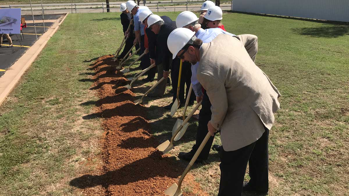 Officials and volunteers break ground on the Howard College Construction Trades Center. (LIVE! Photo/Joe Hyde)
