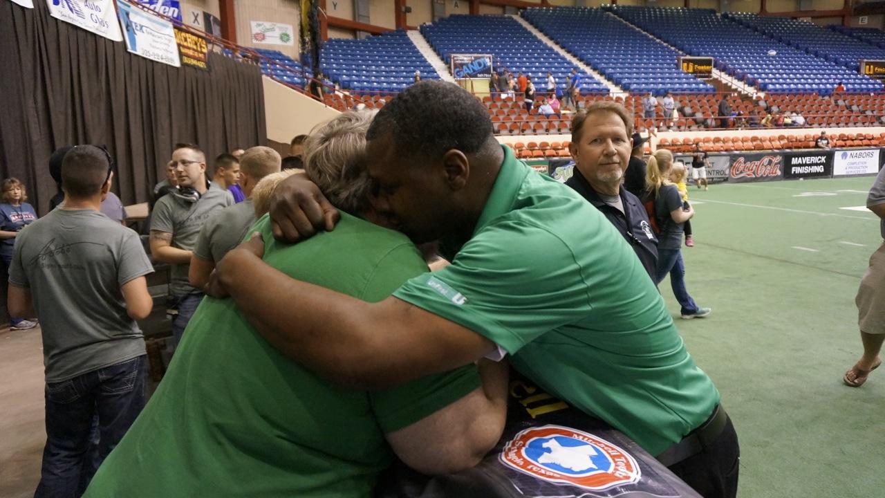 The winning game hug, Coach Wendall Harris and team owner Randy Sanders. (LIVE! Photo/Joe Hyde)