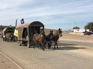 Santa Fe trail riders 2018 ride across San Angelo City limits kicking off Rodeo.  Zoey Hanrahan photo