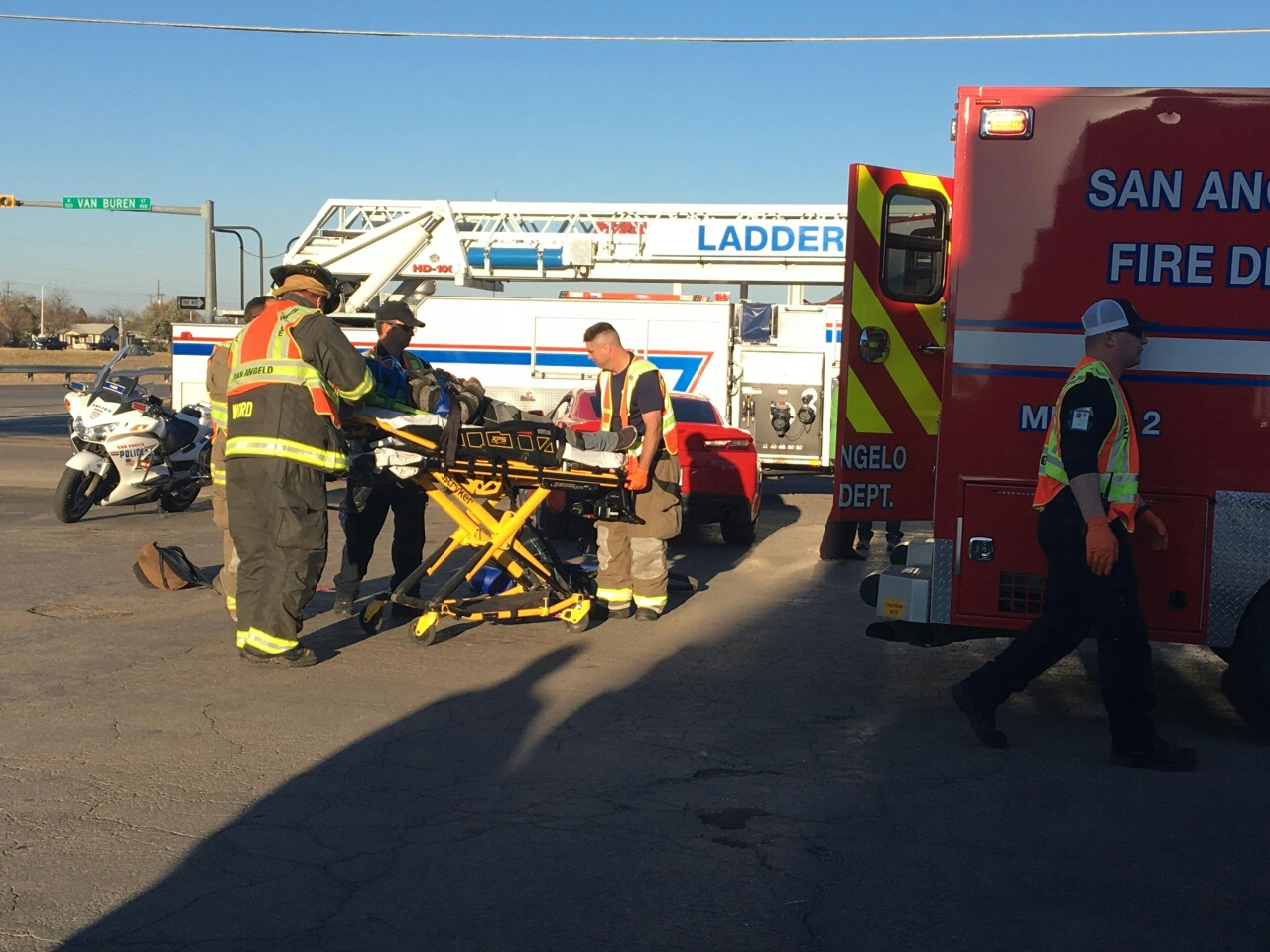 Bicyclist struck by Camero being tended to by first responders.  Sam Fowler photo.