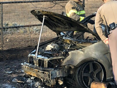 Car destroyed by fire Saturday.  John Bazquez photo.
