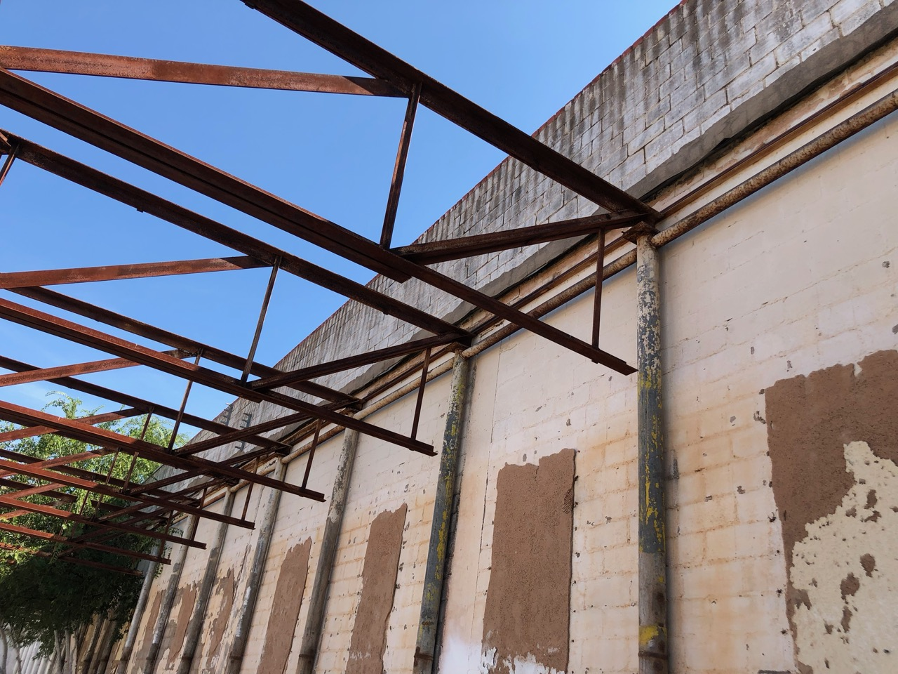 The walls of the adjacent building may have been shared with the old bowling alley, although piers separate from the building hold up the steel trusses. (LIVE! Photo/Joe Hyde)