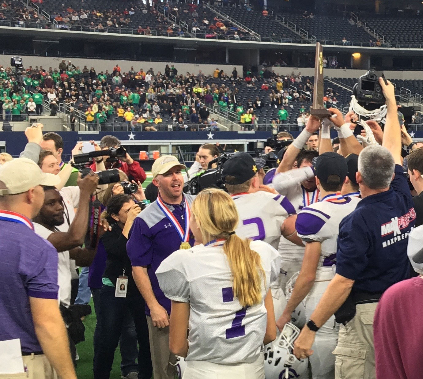 Coach Kade Burns holds the state champs trophy high. (LIVE! Photo/Kendal Hemphill)
