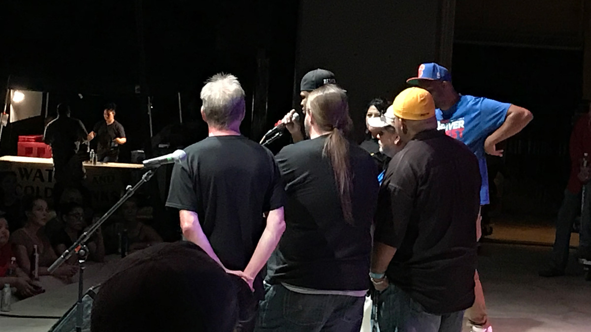 Rapper Chamillionaire (at mic) thanks San Angelo for raising over $10,000 for Hurricane Harvey relief for his foundation, Robin's Heart, at the concert. (LIVE! Photo/Joe Hyde)