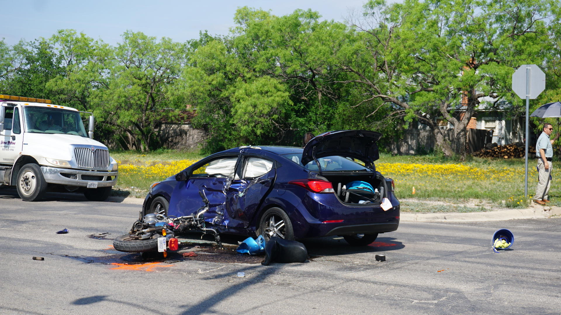 A car and motorcycle collide on Bell and Preusser (LIVE! Photo/Cameron Niblock)