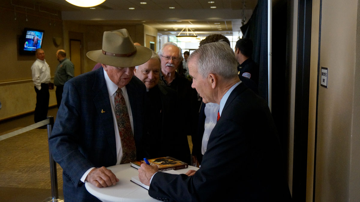 James Powell, who served on the aircraft carrier U.S.S. Oriskany during the Korean War era, gets a book signed by Oliver North in San Angelo on April 6, 2017. (LIVE! Photo/Joe Hyde)