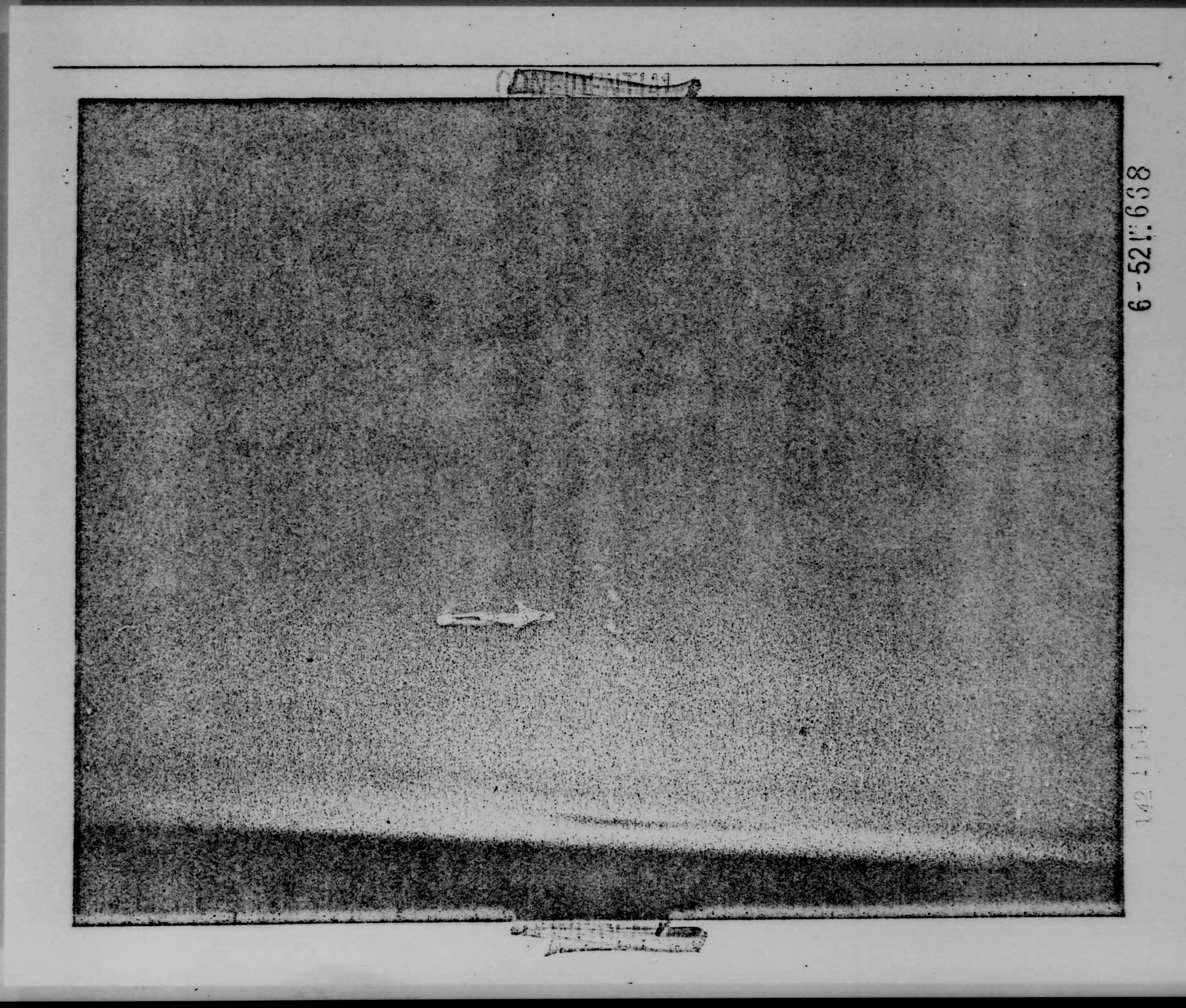 A terrible copy of the photograph contained in the National Archives. In the center, you can see a hand-drawn arrow pointing towards the 7 unidentified objects observed from the RB-36 crew. (National Archives)
