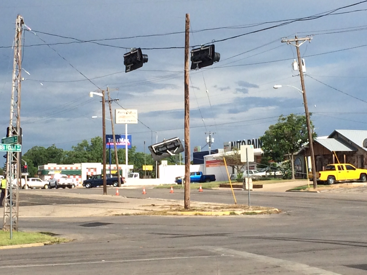 A large truck snagged the overhung traffic lights at Ave. N and Ben Ficklin on June 15, 2015. (LIVE! Photo/John Basquez)