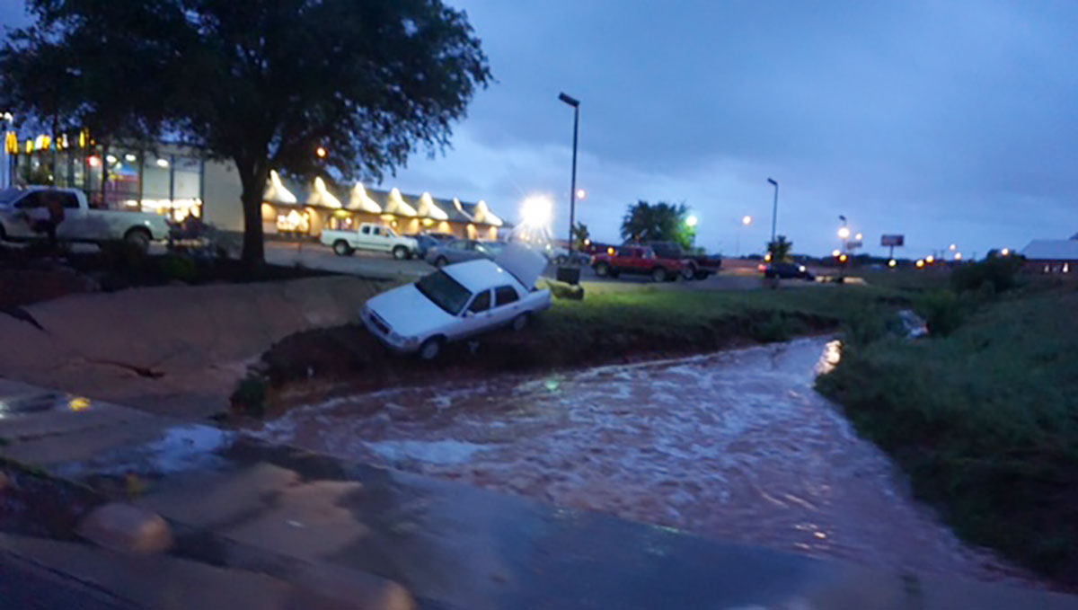 A car that was washed away in the Red Arroyo near the McDonald's on Sunset last night. (LIVE! Photo/John Basquez)