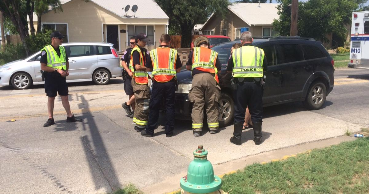 A black Dodge Journey was damaged and its occupants sent to the hospital on July 6, 2015. (LIVE! Photo/Benjamin Hettick)