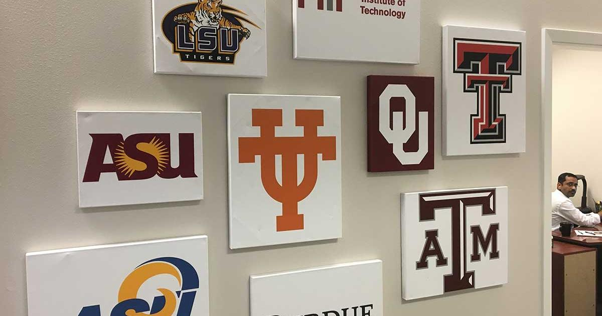 The wall near the software development area that describes from where the team members went to school. (LIVE! Photo/Joe Hyde)