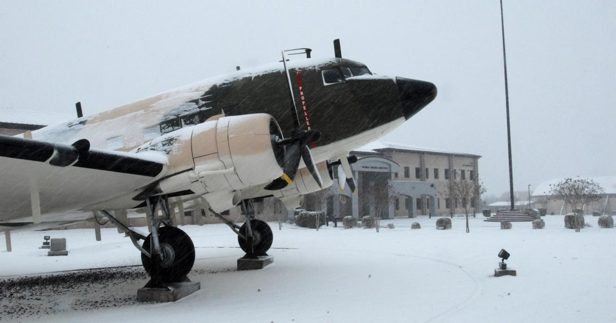A Douglas EC-47Q Electric Goon stands poise as snow collects on its frame and covers the ground around the Norma Brown Building Feb. 23, 2010. (Contributed/Goodfellow AFB)