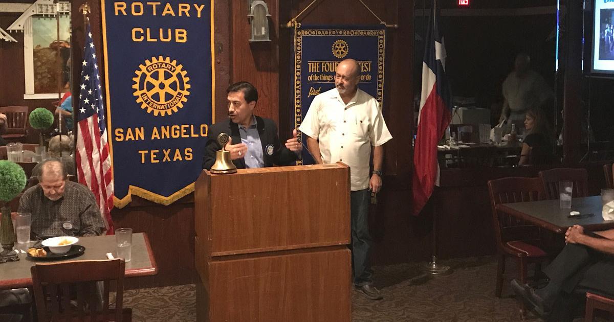 San Angelo Rotary Club President Roland Pena (left) introduced Kevin Reynolds, Director of the House of Faith. (LIVE! Photo/Joe Hyde)