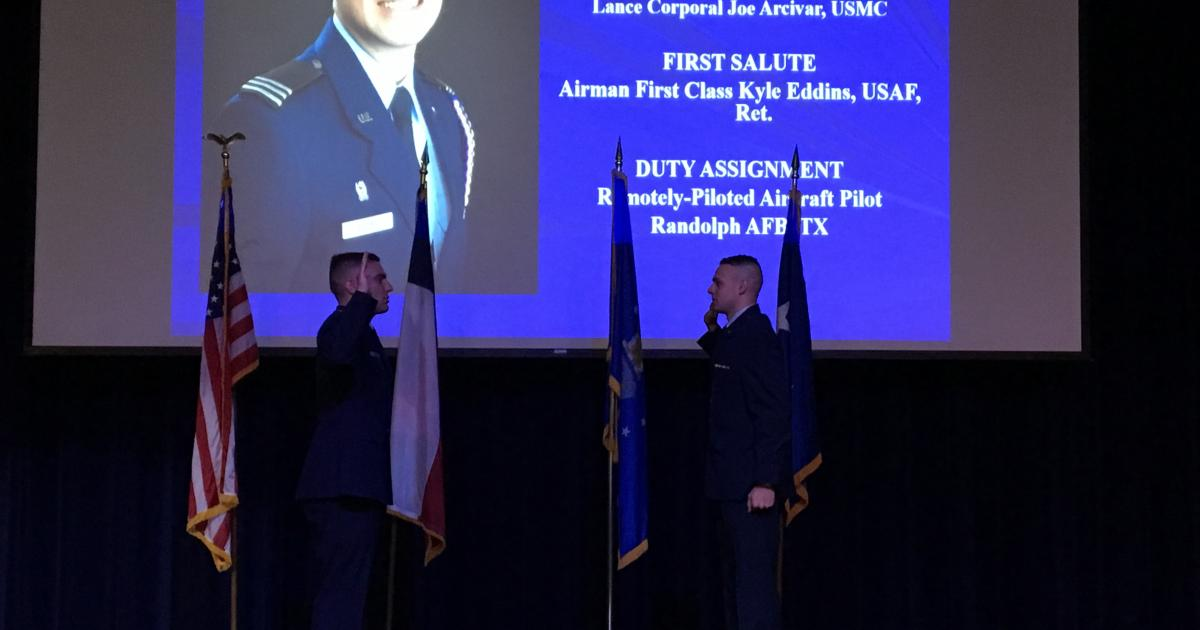 2nd Lt. Matthew Eddins is read the oath of office by Capt. Jacob Glantz, USAF.