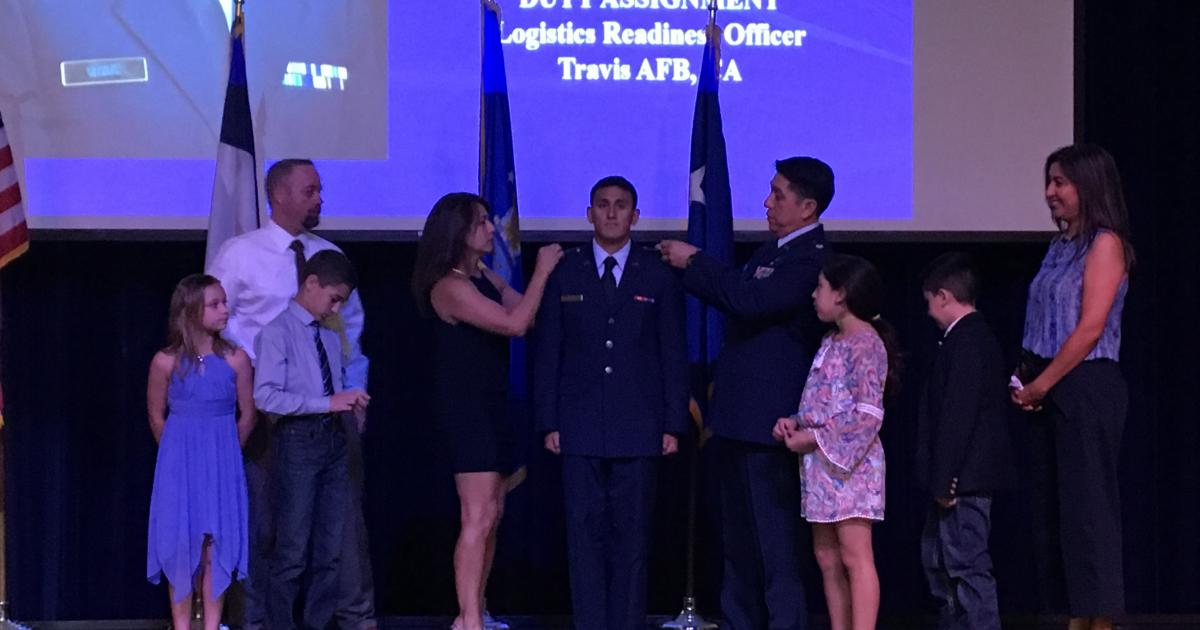 New 2nd Lt. Edward Reyes has his ranks pinned on by father Lt. Col Raul Reyes and mother Elizabeth Kemp