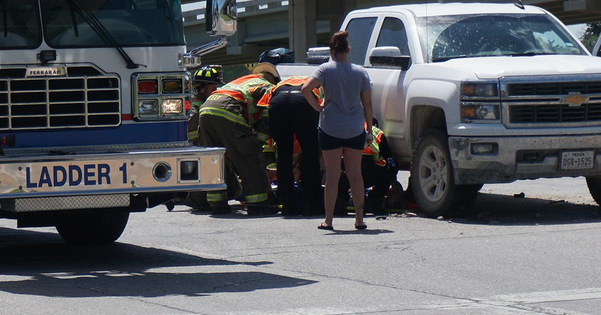 The motorcyclist is treated near the truck he hit. (LIVE! Photo/John Basquez)