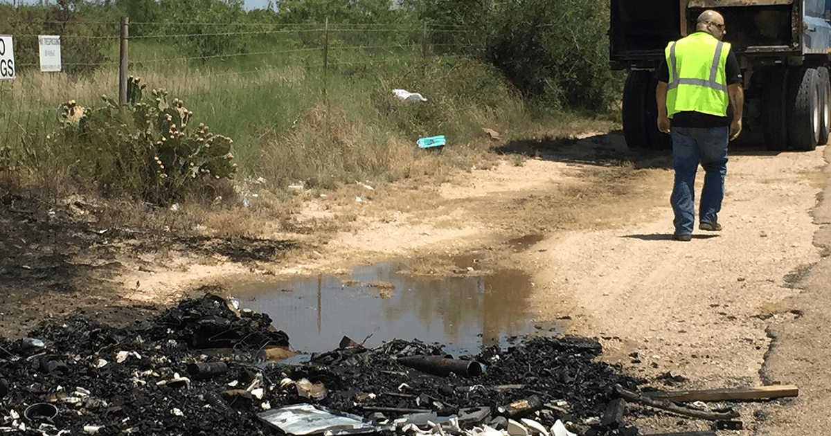 A Republic Services trash truck hauling dumpster trash caught fire on July 22, 2015. (LIVE! Photo/Megan Holmquest)