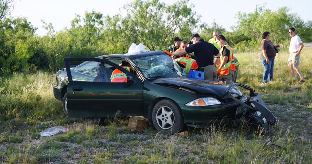 Firefighters and EMS use the Jaws-of-Life to extract the trapped driver in a Chevrolet Cavalier. (LIVE! Photo/John Basquez)