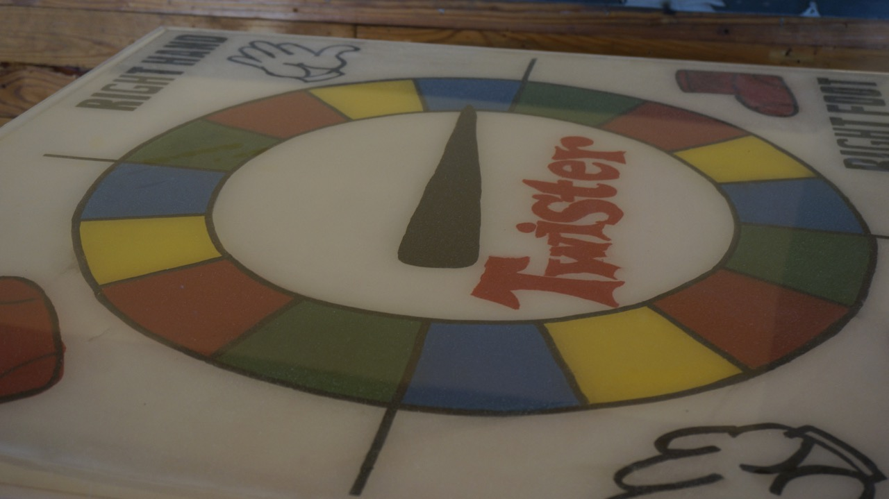 """One table has a replica of the 1960s-era """"Twister"""" game that both partners fondly remember from their childhood in west Texas. (LIVE! Photo/Joe Hyde)"""
