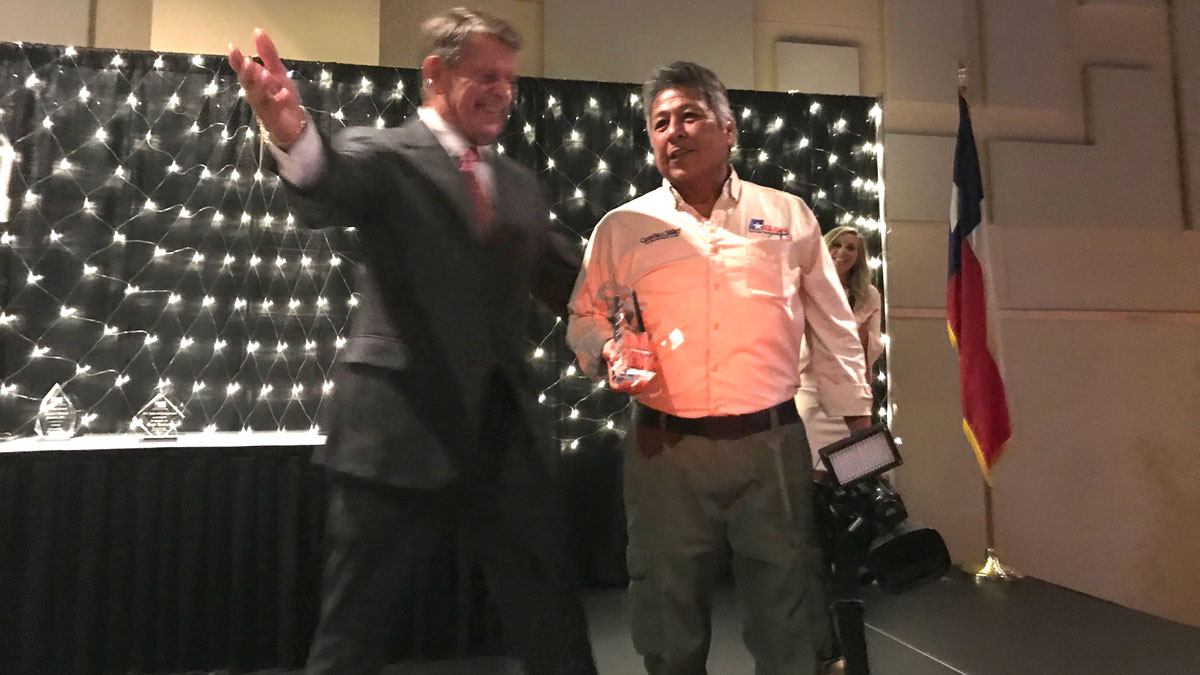 Foster Communication's Fred Key presented the Walton Foster Excellence in Media Award was given to KLST-TV photographer Freddy Deanda. (LIVE! Photo/Joe Hyde)