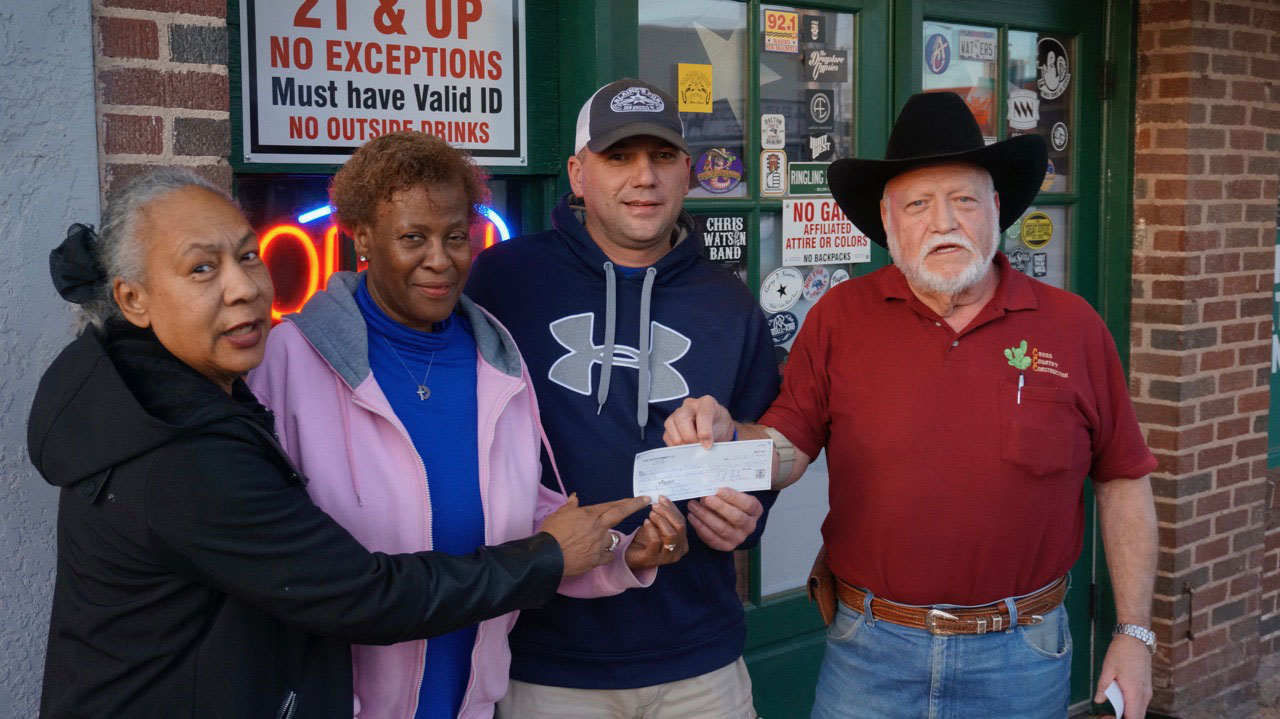 Pamela Burke and Ola McCorkle of the Wesley Trinity Daily Bread receive a $3,100 check for their organization. (LIVE! Photo/Joe Hyde)