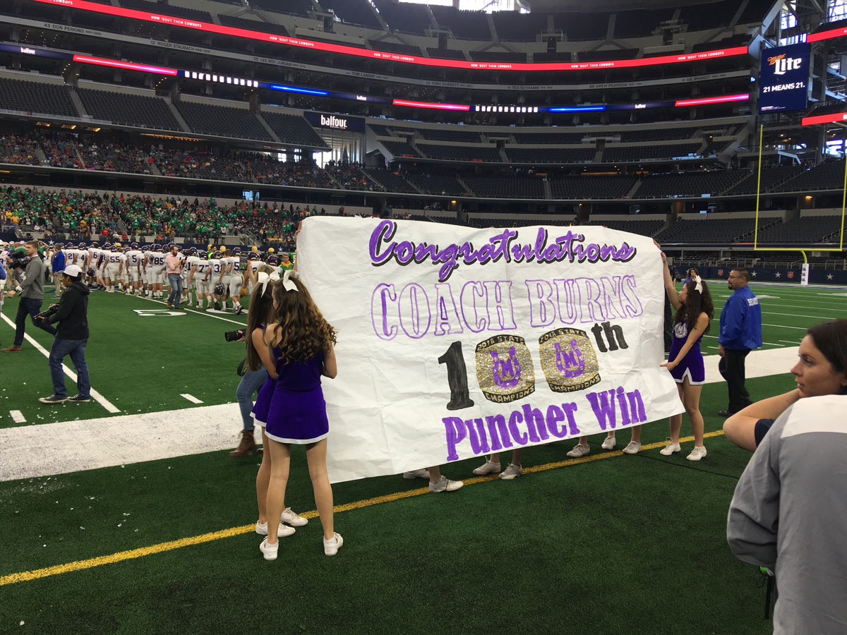 After defeating New Deal to win the Class 2A Div. 1 State Championship, a banner displayed congratulates Coach Kade Burns for his 100th win. (LIVE! Photo/Kendal Hemphill)
