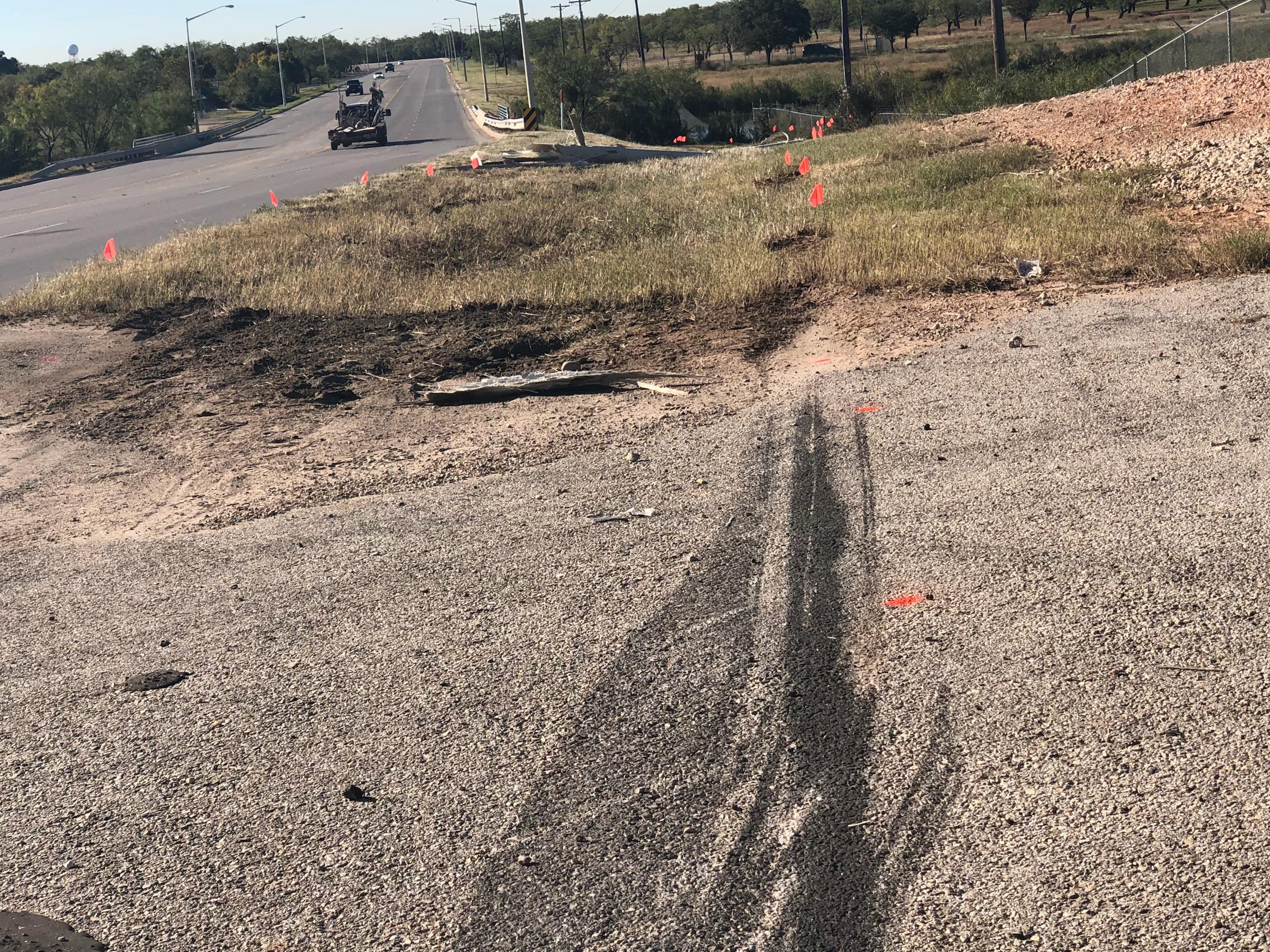 The San Angelo police investigation markets show the track of the Mustang as it left the prepared surface. (LIVE! Photo/Sam Fowler)