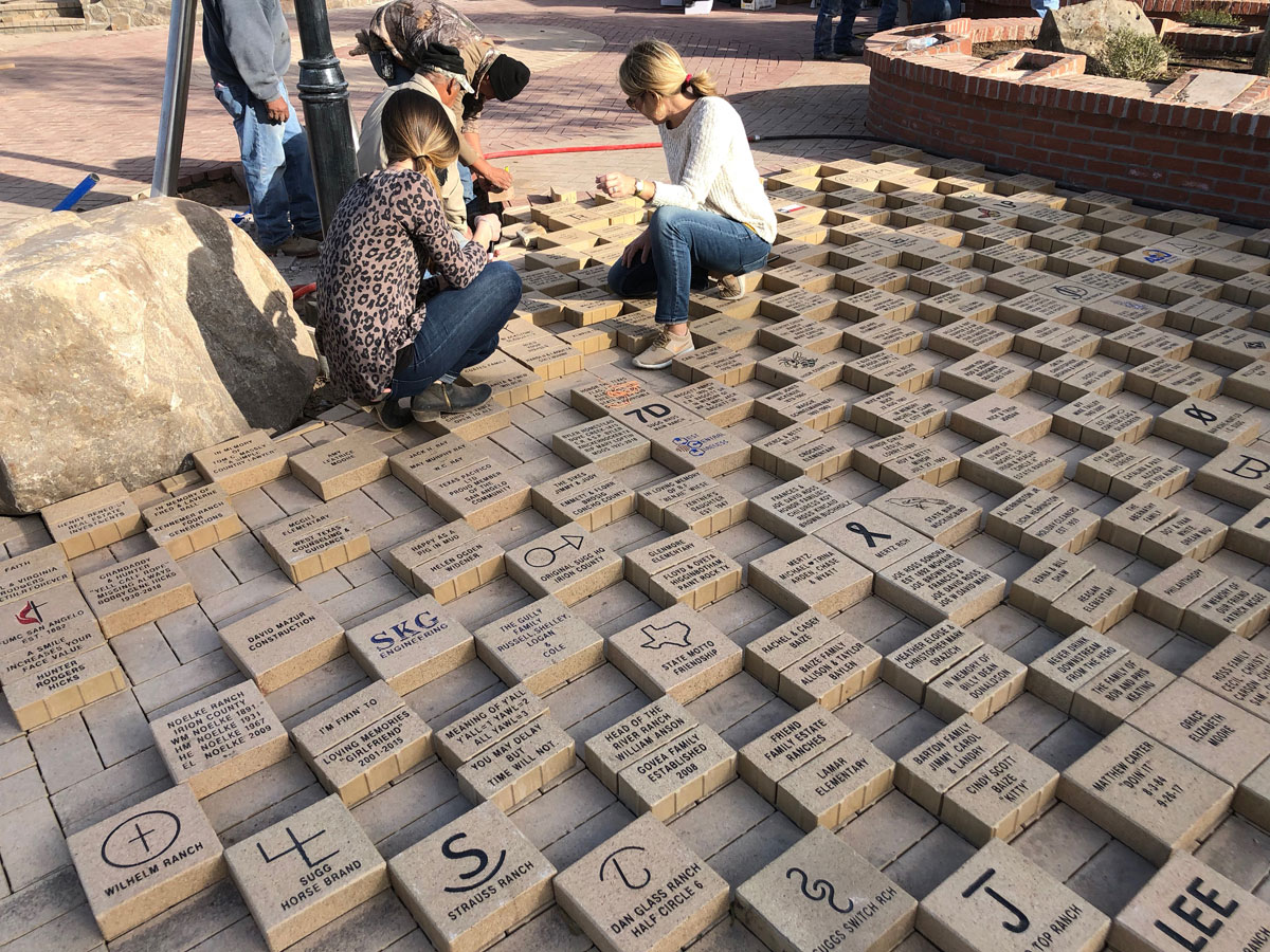 Placing bricks purchased by donors to finance the park. (LIVE! Photo/Joe Hyde)