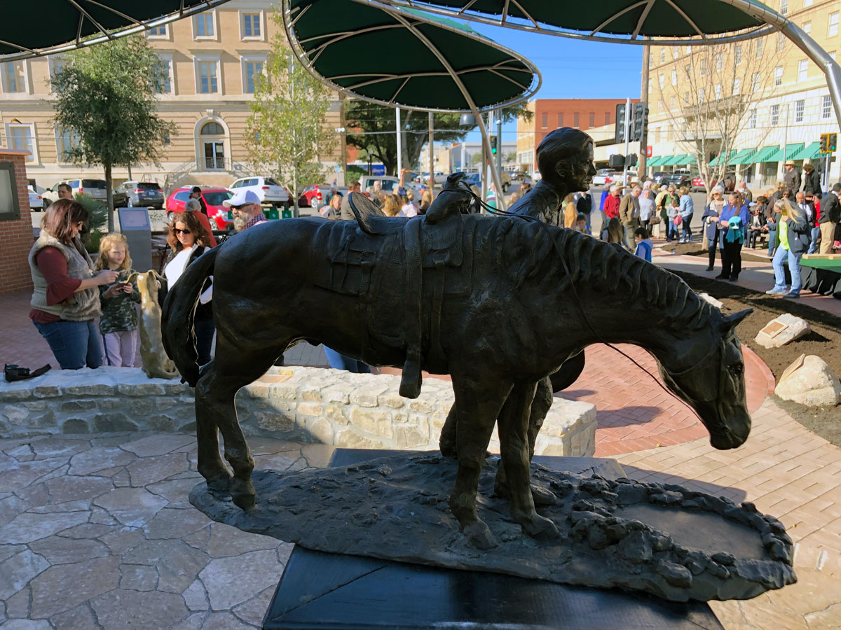 A model of the centerpiece statue of a cowboy and his horse stands in for the much larger statue that will be installed in several weeks. (LIVE! Photo/Joe Hyde)