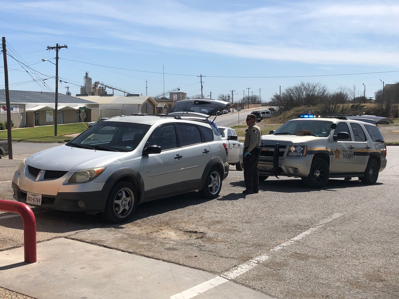 Law enforcement operations were underway Wednesday afternoon (March 21, 2018) at the Stripes at the corner of Knickerbocker and Austin. (LIVE! Photo/John Basquez)
