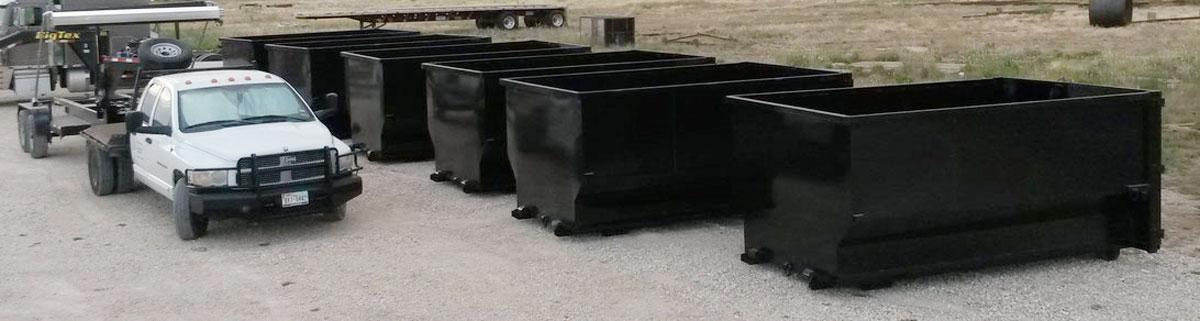 A row of J-Bar's popular 18-cu. yd. roll-off trash bins. (J-Bar Solutions)
