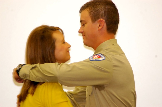JaNelle Lange pins the fireman's badge on husband Jaden.