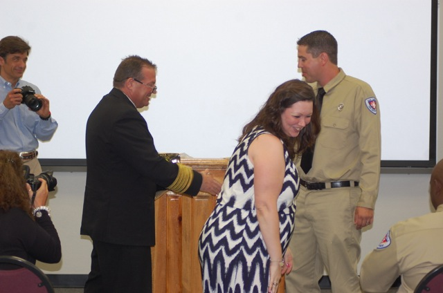 Megan Huddleson pins the badge on husband Jon