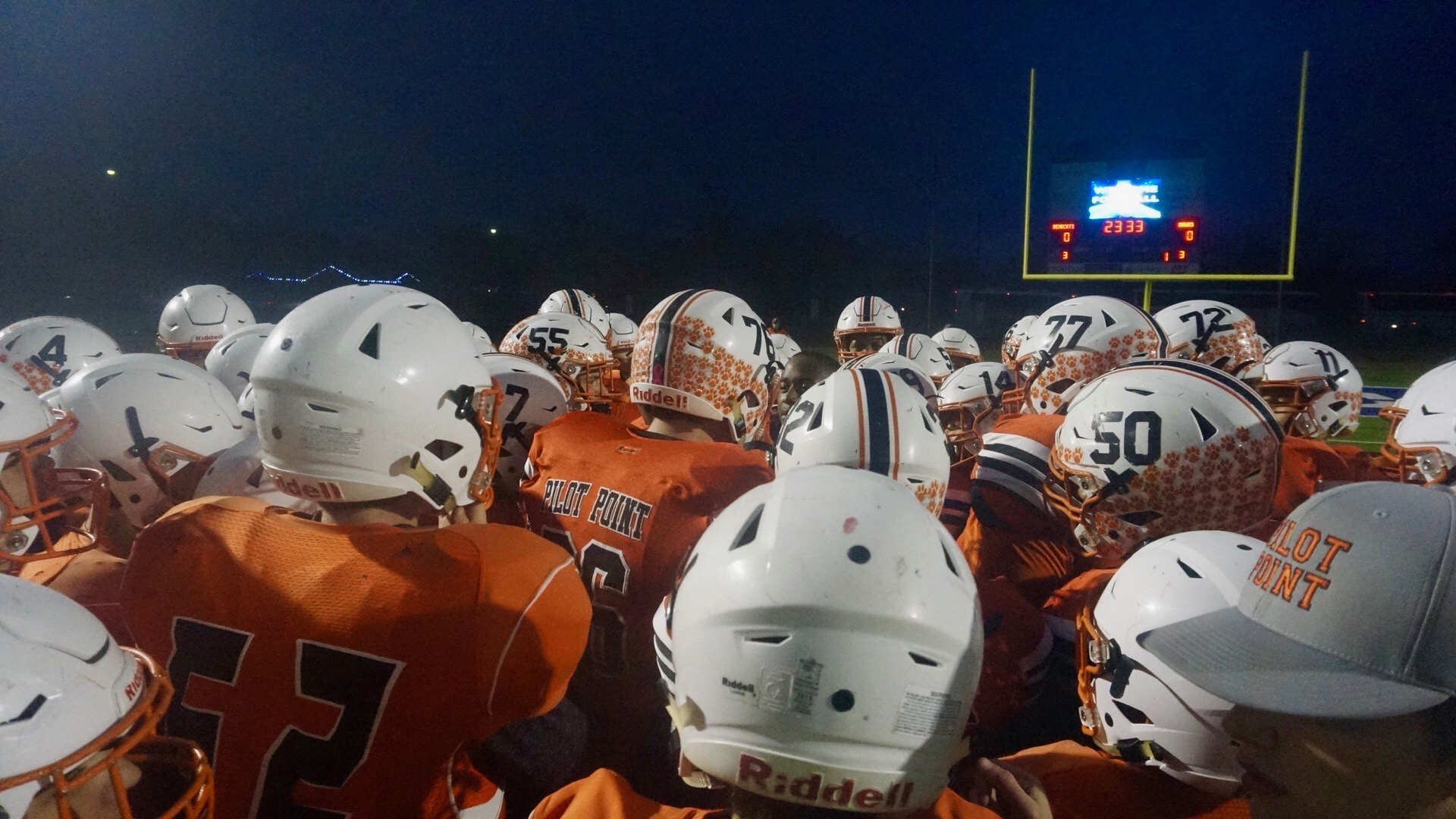 The Pilot Point Bearcats gather before running onto Newton Stadium field in Graham, Texas to start the regional playoff against the Wall Hawks on Nov. 29, 2019. (LIVE! Photo/Joe Z. Hyde)