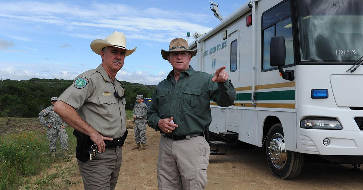 Texas Game Warden Jeff Gillenwaters and Chris Zimmer, deputy director for Fort Hood's Directorate of Emergency Services, discuss search and recovery efforts for four missing Fort Hood, Texas Soldiers June 3. (Fort Hood Public Affairs)