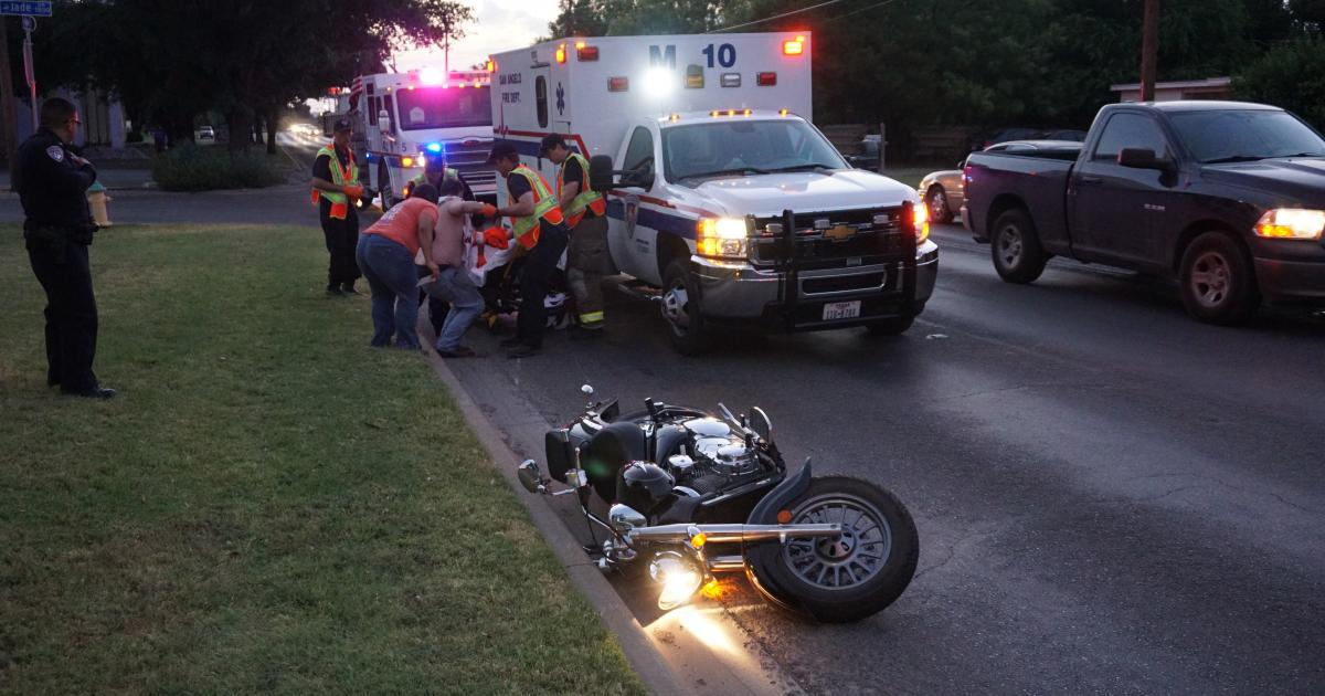 Motorcycle Crashes to Avoid Tahoe on Ave. N on July 31, 2015 (LIVE! Photo/John Basquez)