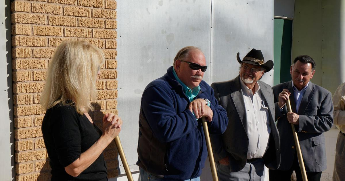 Michael Biggerstaff (2nd from left) describes his vision for the old Roosevelt Hotel. (LIVE! Photo/Joe Hyde)